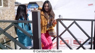 Two young woman on a winter ski vacation