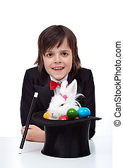 Boy performing easter magic - Easter magic - boy pulling a...