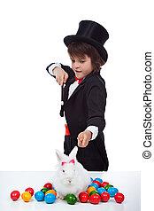 Magician boy doing an easter trick