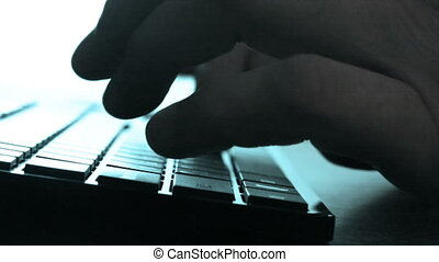 Male fingers printing on keyboard close up - Close up view...
