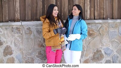 Attractive young women in stylish winter fashion