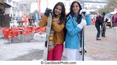 Happy female friends at a winter ski resort - Happy...