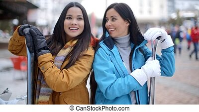 Two gorgeous young brunette snowboarders