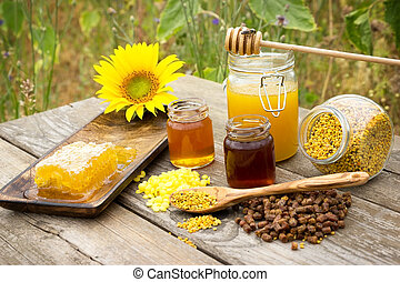Bee products - Various bee products placed on a wooden table