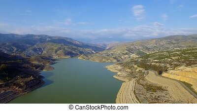 4K Aerial, Flight over barrier lake - Shot is additionally...