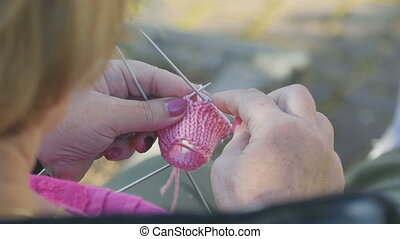 Knitting socks - Grandmother knits socks for little...