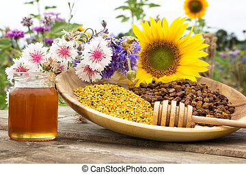 Bee products - Arrangement with various flowers and bee...