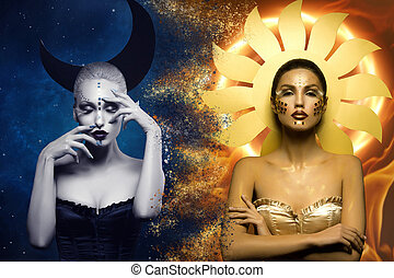 Moon and sun girls - Two beautiful young women dressed as...