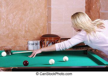 Blonde playing pool
