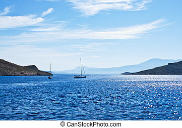 Sailing boat on Aegean sea near Nisyros Island. Greece....