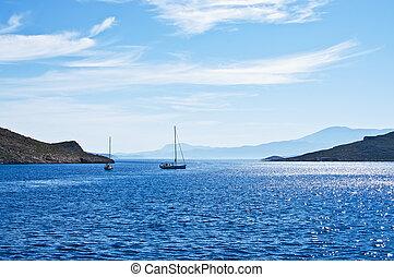 Sailing boat on Aegean sea near Nisyros Island. Greece....