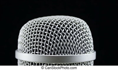 Microphone Rotates on a Black Background - Studio microphone...