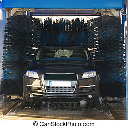 car wash - black sports car in a car wash