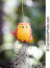 Ceramic doll hung swing in the garden