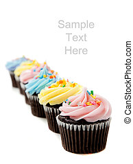 Pastel cupcakes on a white background with copy space