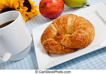 croissant with apples and coffee on a gingham tablecloth - A...