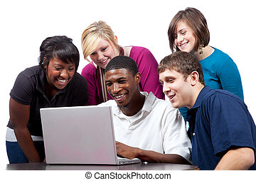 Multi-racial college students sitting around a computer - A...