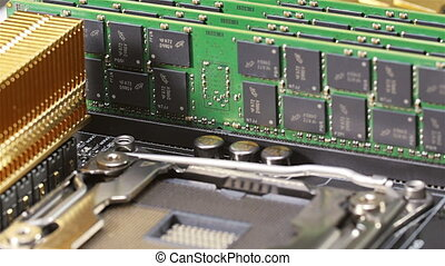 Memory modules (RAM) and CPU socket on server main board,...