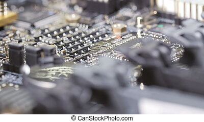 Macro view of computer circuit board, sliding video