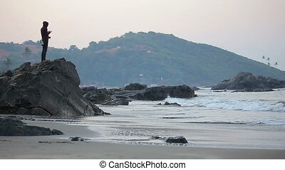 Photographer enjoys early morning seascape - Photographer...
