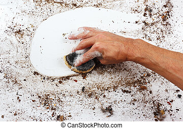 Hand with wet sponge wiping heavily dirty surface - Hand...