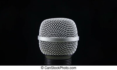 Microphone Rotates on a Black Background