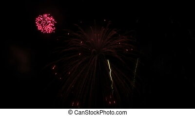 Red fireworks display against a black background. Seamlessly...