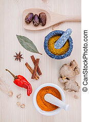 Dried herbs and spices nutmeg,star anise ,cinnamon stick ,ginger ,bay leaves and chili on wooden table. Top view with copy space.
