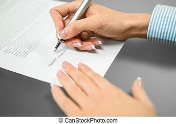 The last signature needed - Woman puts a signature The last...