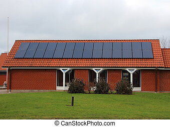 Sun Solar Panel Cell on Roof of Red House - Sun Solar Panel...