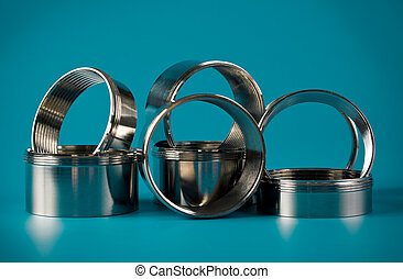 steel chromium-plated rings with thread on a blue background