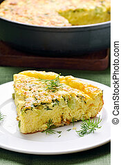 Omelette with herbs, cheese and zucchini