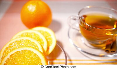 Cup of Tea, Glass Teapot, Oranges on a Tablecloth - Glass...