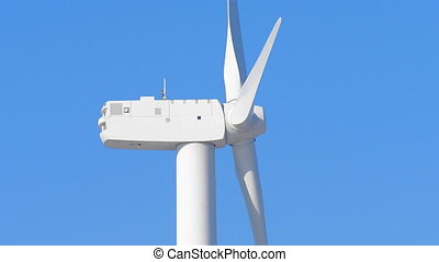 Wind turbine spinning close up side - Close up of wind...