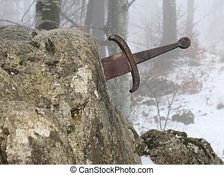 legendary Excalibur sword into the stone in the middle of...
