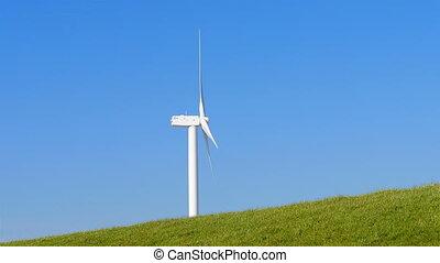 Wind turbine behind levee Holland - Wind turbine behind...
