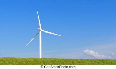 Wind turbine left side grass field - Wind turbine on the...
