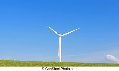 Wind turbine green field clouds - Wind turbine in green...