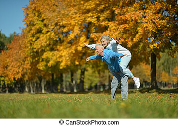 Mature couple having fun in the  park