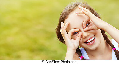 glasses of the fingers - portrait of a cheerful girl who...
