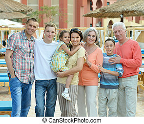 Family relaxing at resort - Portrait of a Happy family...