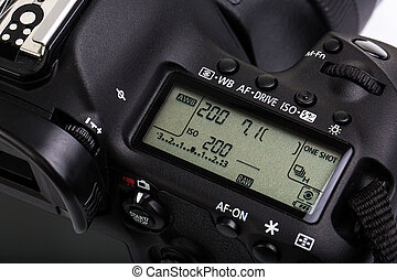Professional modern DSLR camera - detail of the top LCD with...