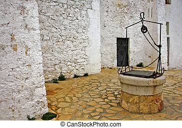 water well - view of a courtyard with an old water well