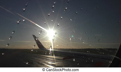 Sun shines raindrops aircraft view