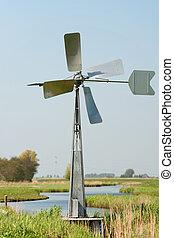 Watermill in vertical Dutch landscape