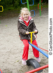 Playing at the playground - Little girl is playing at the...