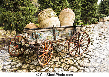 Old horse drawn wooden cart with jars