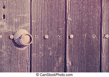 Old wooden door with handle. Photo in vintage style