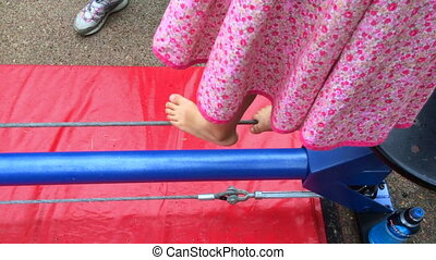 Tightrope walking - Feet of a child (girl age 5-6) tightrope...