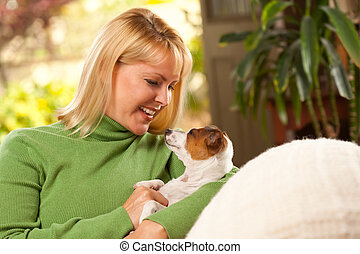 Woman and Puppy Enjoying Their Day on The Sofa - Woman and...
